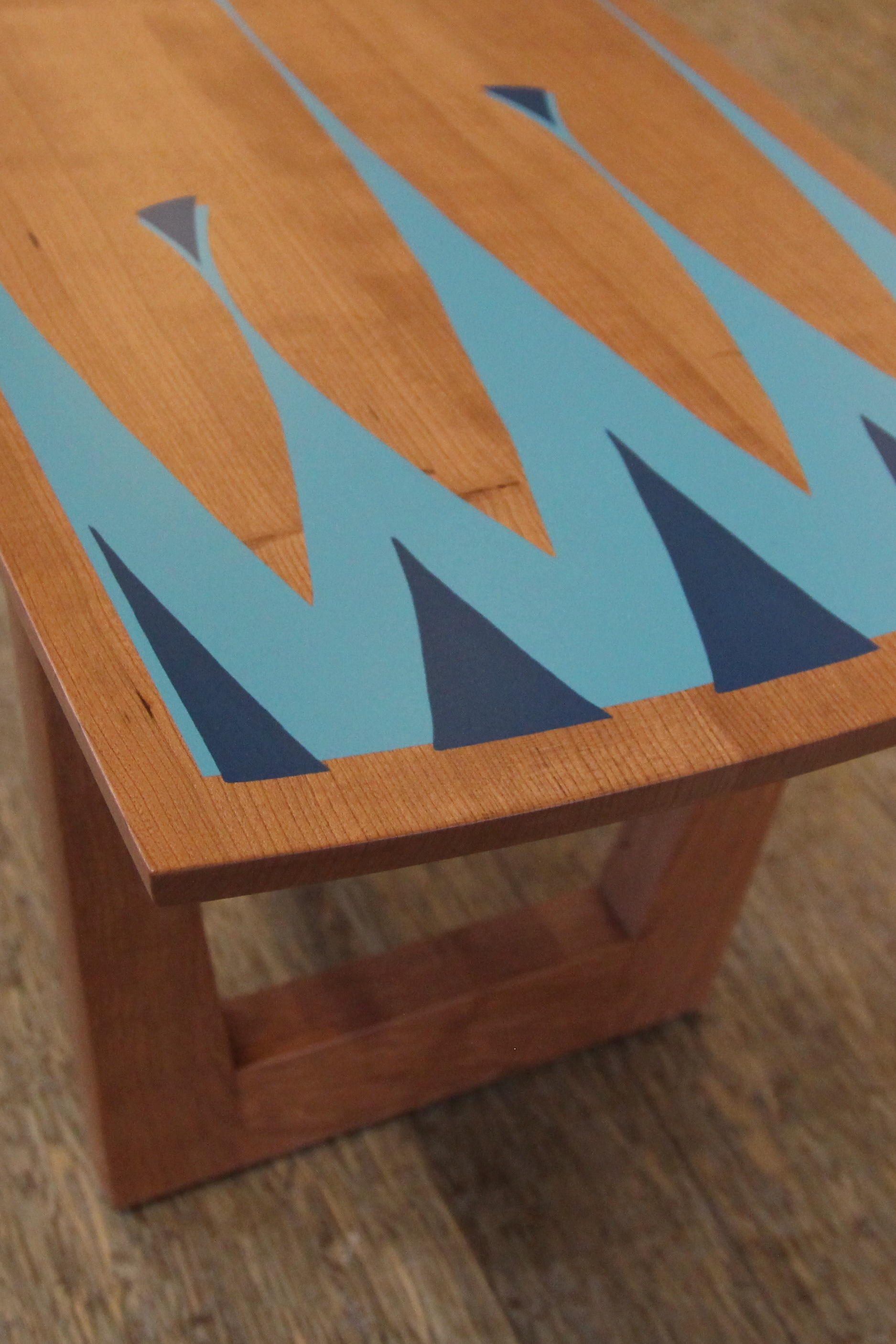 Cherry wood coffee table, with teal and light blue overlay.